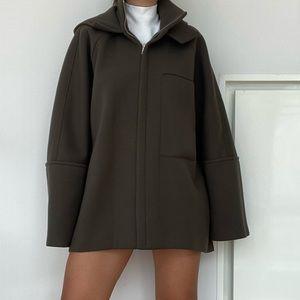 Green coat from Concept Korea